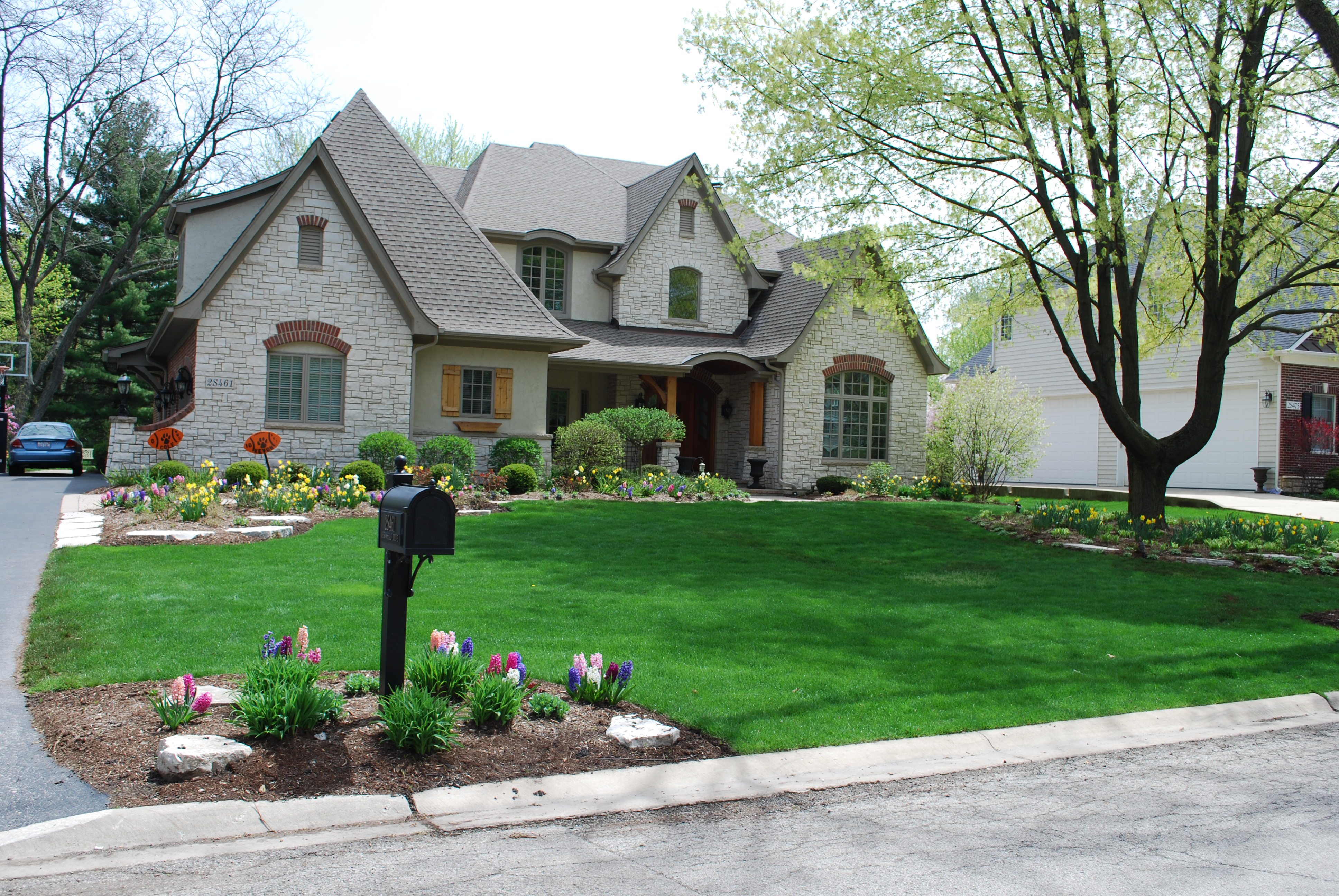 Adding a large plant bed along the entry walk and driveway for Driveway addition ideas